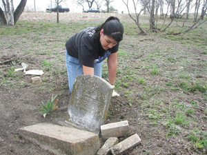 "Lehman NHS member Jacqueline Robles provides hadn-trimming care to a Coronado Cemetery gravesite in her group's ""RIP Guardian Program"" workday in March, 2007"