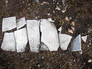 This beautifully hand-crafted marble tombstone, broken into several pieces, is currently receiving professional restoration and will be returned to its original site in the fall of 2008.