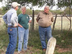 Land-owner Scott Marshall (left) discusses the history of the Reaves Cemetery with HCHC Cemetery Committee members Dorothy Gumbert and Bob Flocke during the committee's recent visit in Driftwood. Linda Coker and Jim Cullen also joined the group.