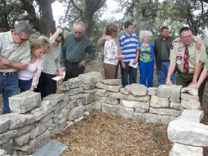 Following the March 7, 2009, re-consecration of the Burns Sons' Gravesite, attendees appreciatively take in the young brothers' Hill Country gravesite.